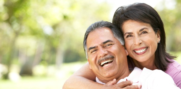 Hispanic couple together smiling