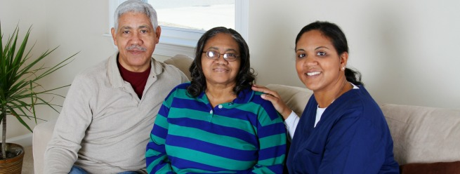 senior couple meeting with a caregiver
