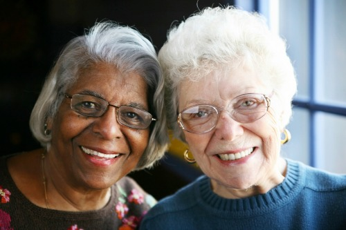 two elder woman together smiling