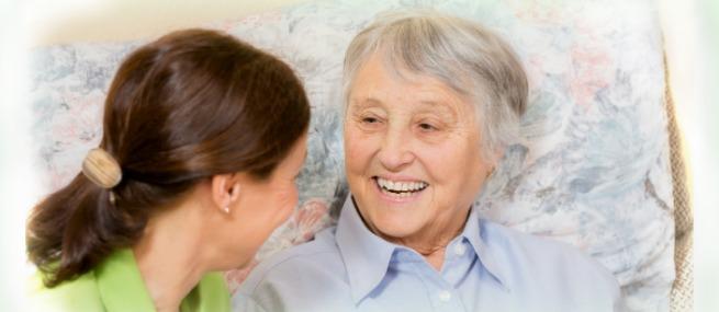Caregiver and Senior Citizen Smiling