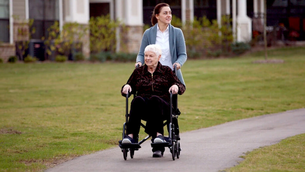 ComForCare franchise Caregiver pushing wheelchair