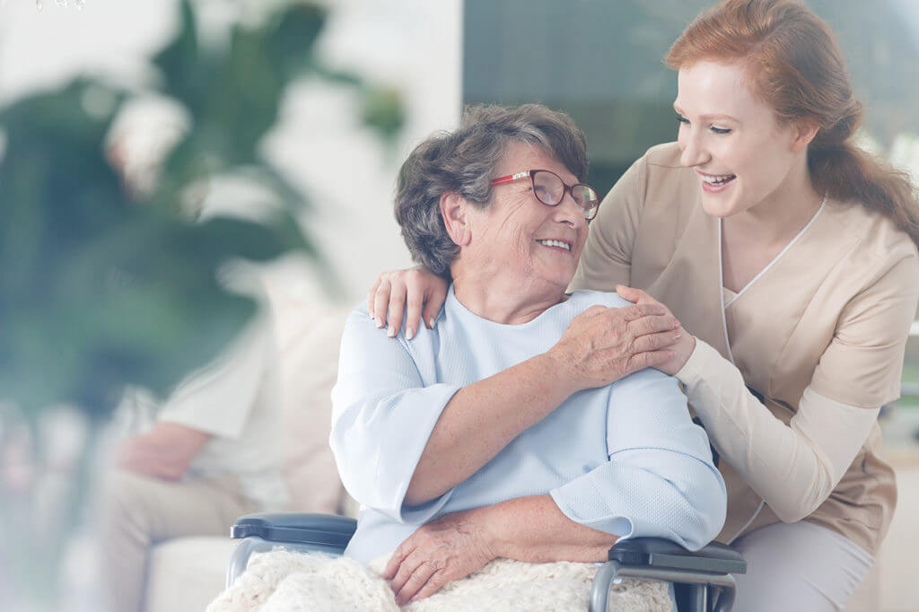 ComForCare caregiver with client