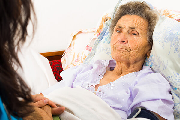 Home nurse caring for elderly woman
