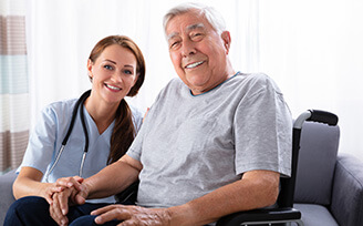 Elderly man smiling with a home nurse